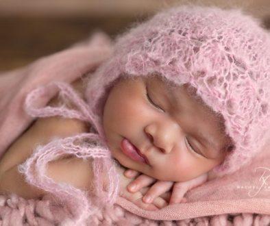 Baby Harper in a beautiful bonnet.