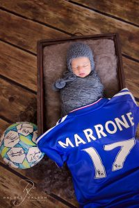 Baby with daddy's prized soccer ball