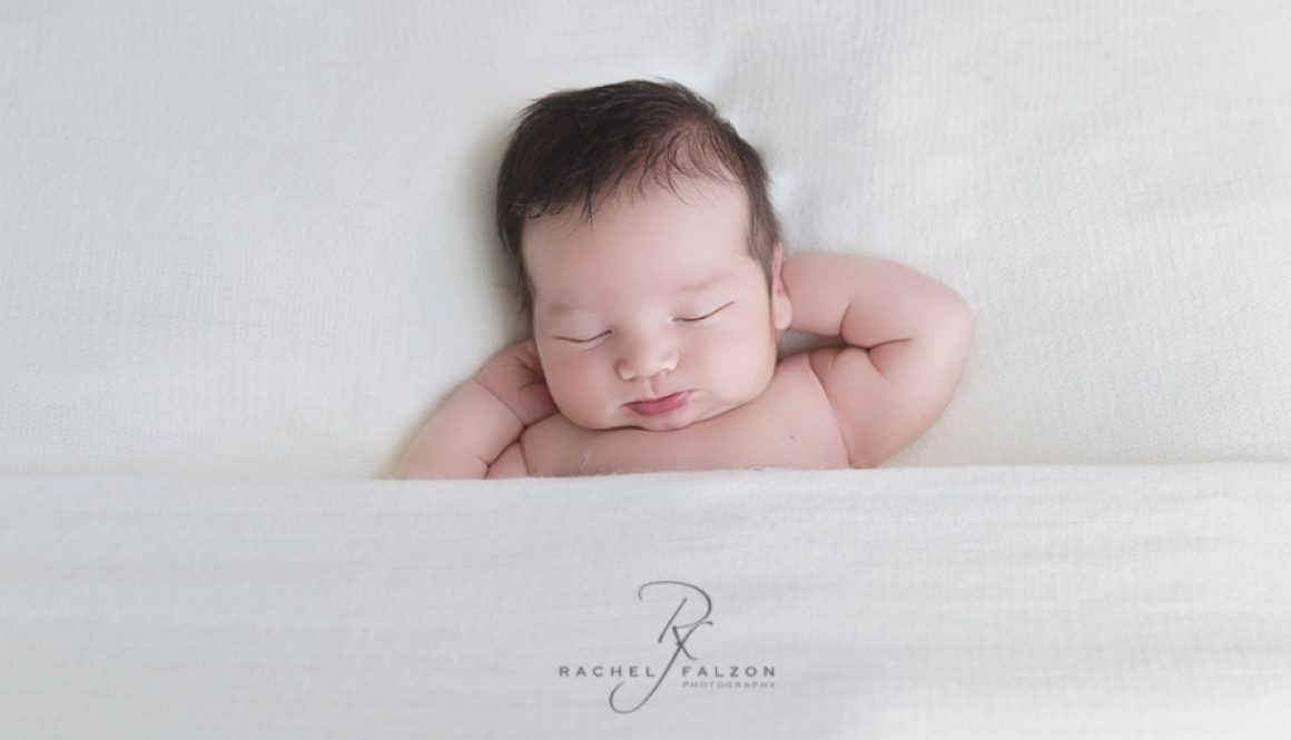 Baby Xander relaxing during his newborn session.