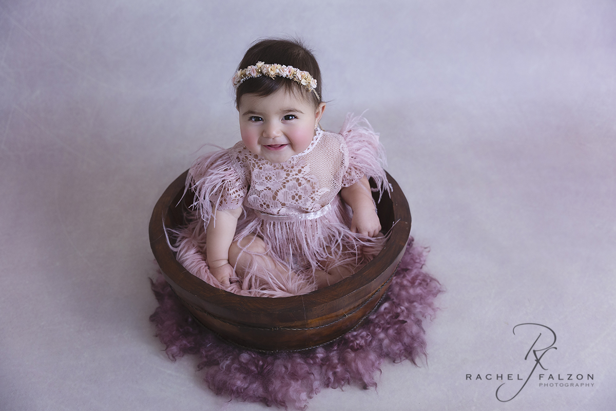 Smiling baby sitting in a bowl penrith photography