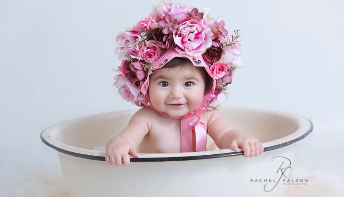 Baby-with-floral-headpiece-in-a-tub
