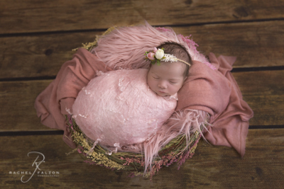 Baby wrapped in pink