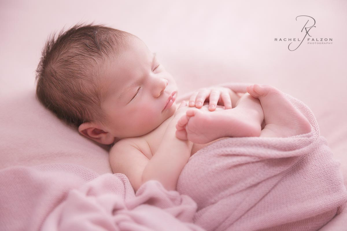 Backlit newborn baby girl