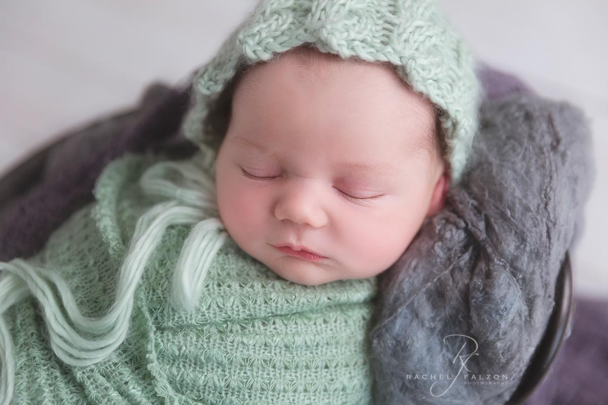 Newborn baby in green western sydney photographer