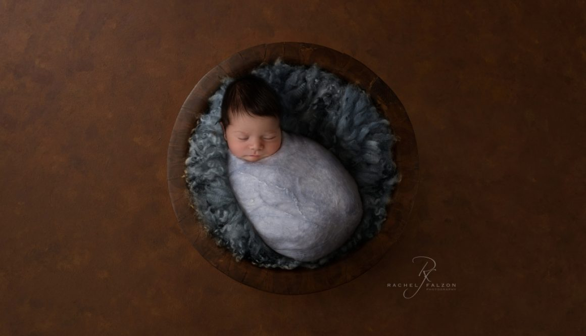 Baby in a brown bowl