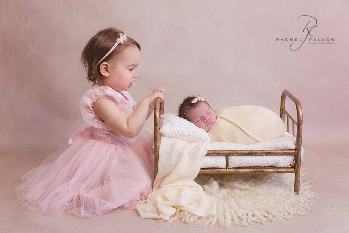 Newborn with her sister penrith photographer