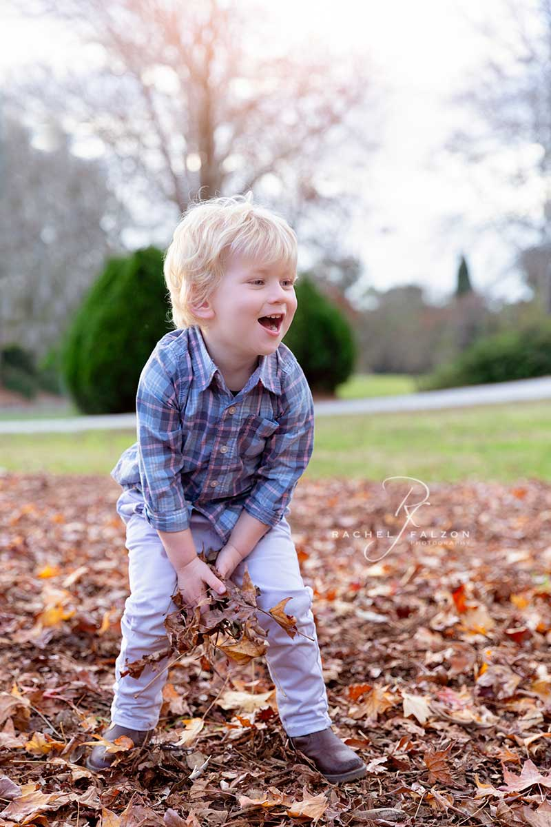 Toddler playing with autumn leaves in Western Sydney